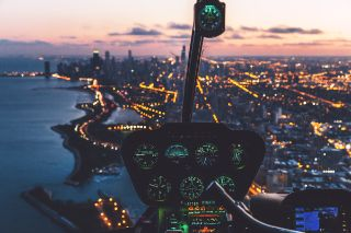 Cockpit with city lights in the background